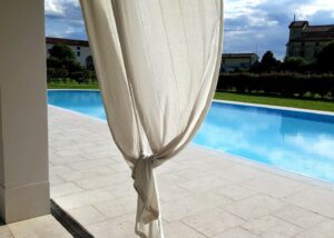 Private pool in an Italian villa clad in Grolla marble